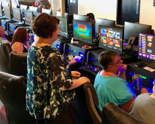 people gamble with electronic pull tabs at Shirley's Charitable Gaming in Louisville, KY