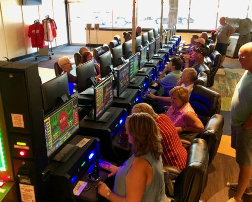 people gambling with electronic pull tabs at Shirley's Charitable Gaming in Louisville, KY